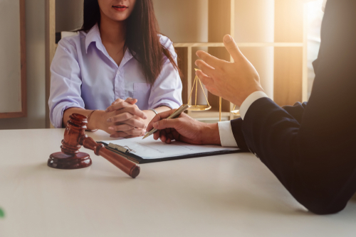 Lawyer explaining workers' compensation laws in 2021 to client