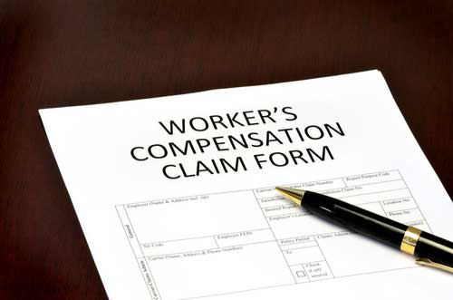 Workers' comp claim form with pen, Lincoln County workers' compensation lawyer concept
