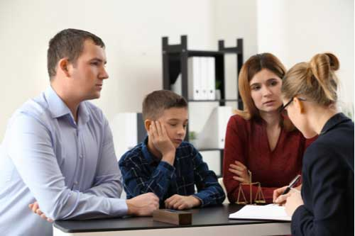Parents with their son visiting Charlotte divorce lawyer, concept of child support