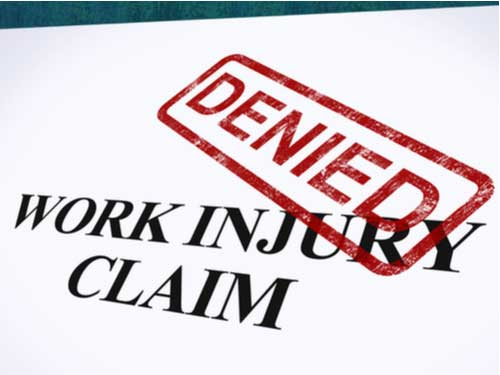 Work injury claim with word denied stamped in red, Monroe workers' compensation lawyer concept