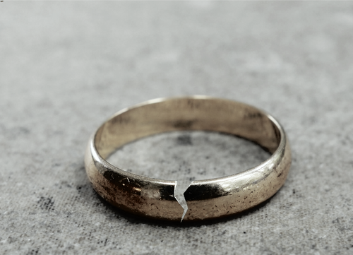 This is an image of a broken wedding ring concept of a divorce with the help of a Mooresville divorce lawyer