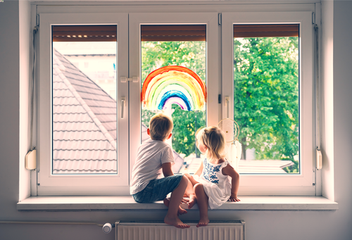 This is an image of children sitting at a window concept of child support with a Gastonia divorce lawyer